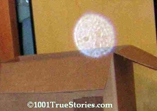 Strange structured round, flying object, invisible for eyes, visible on photos taken with flash
